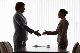 Man and woman negotiating and shaking hands